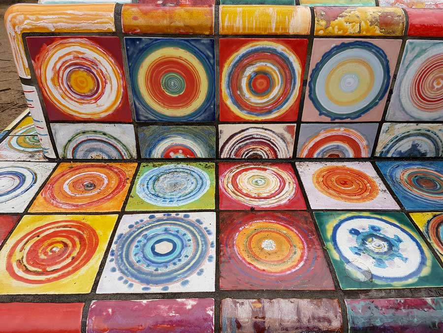 detail of a bench made with colourful ceramic tiles