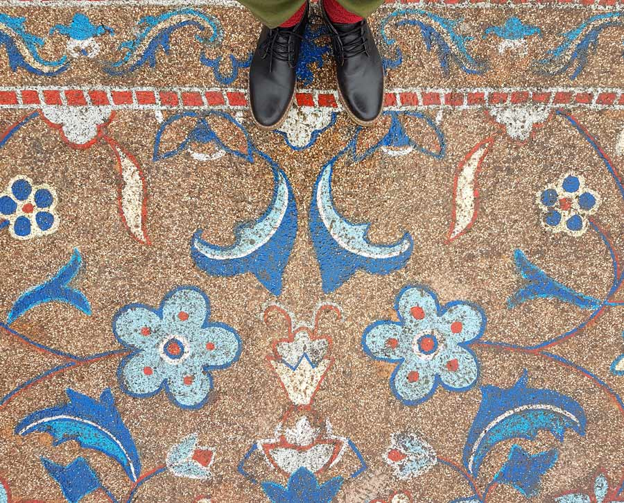 details of stone oriental carpet with flowers