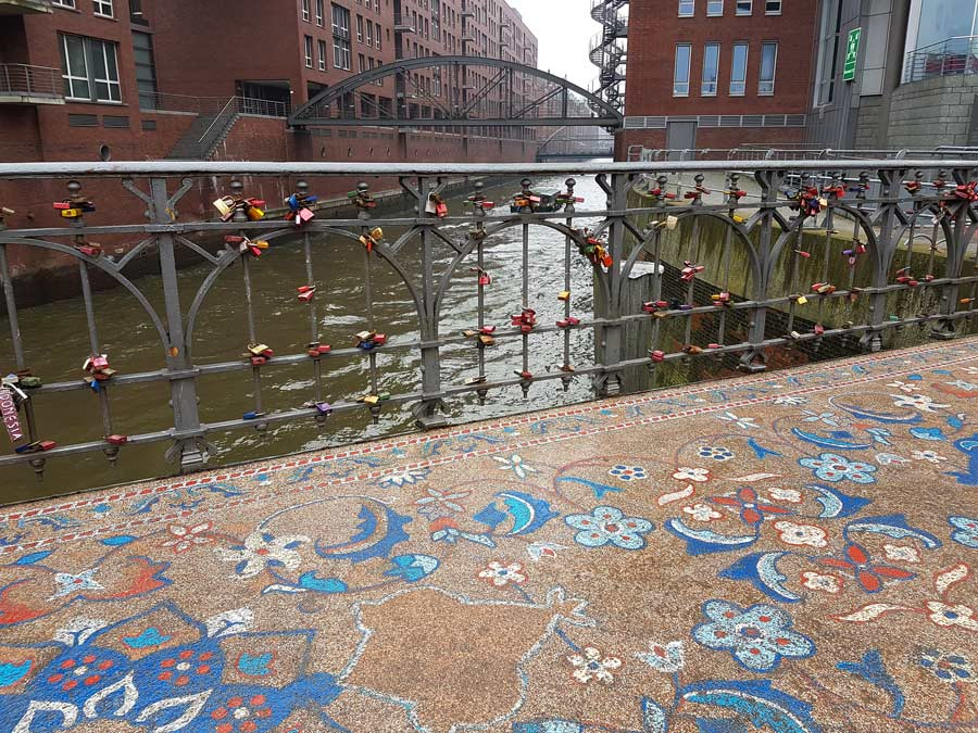 detail of mosaic stone granulate oriental carpet on bridge in hamburg as public art