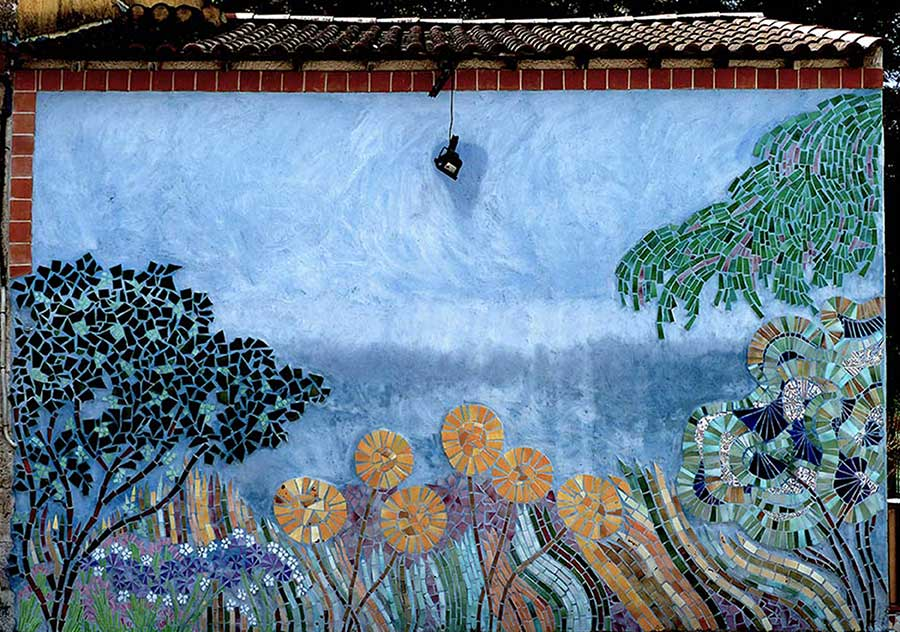 mosaic mural showing trees and flowers
