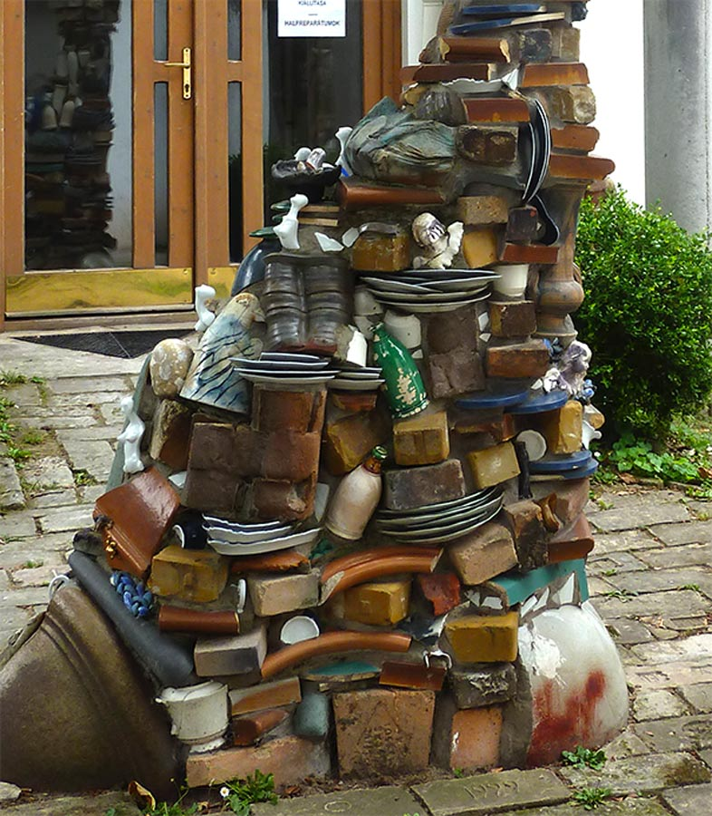 detail of a sculptural pile of broken ceramics held together with cement in the garden of the international ceramic studion in Kecskemét in Hungary